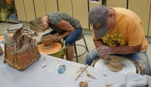 Joan Patrick and Perry Wray at work on the potter's wheel creating bowls for the Empty Bowls project.