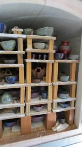 Glaze kiln with fired empty bowls. Credit: Magda Gluszek